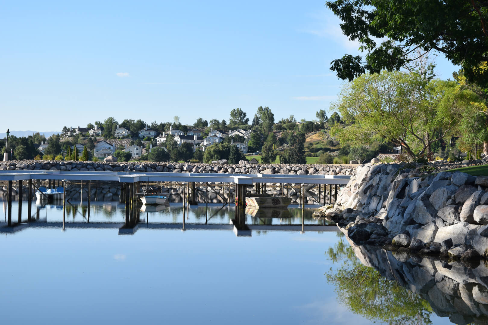 We built a massive rock retaining wall to eliminate erosion and preserve this pond island.