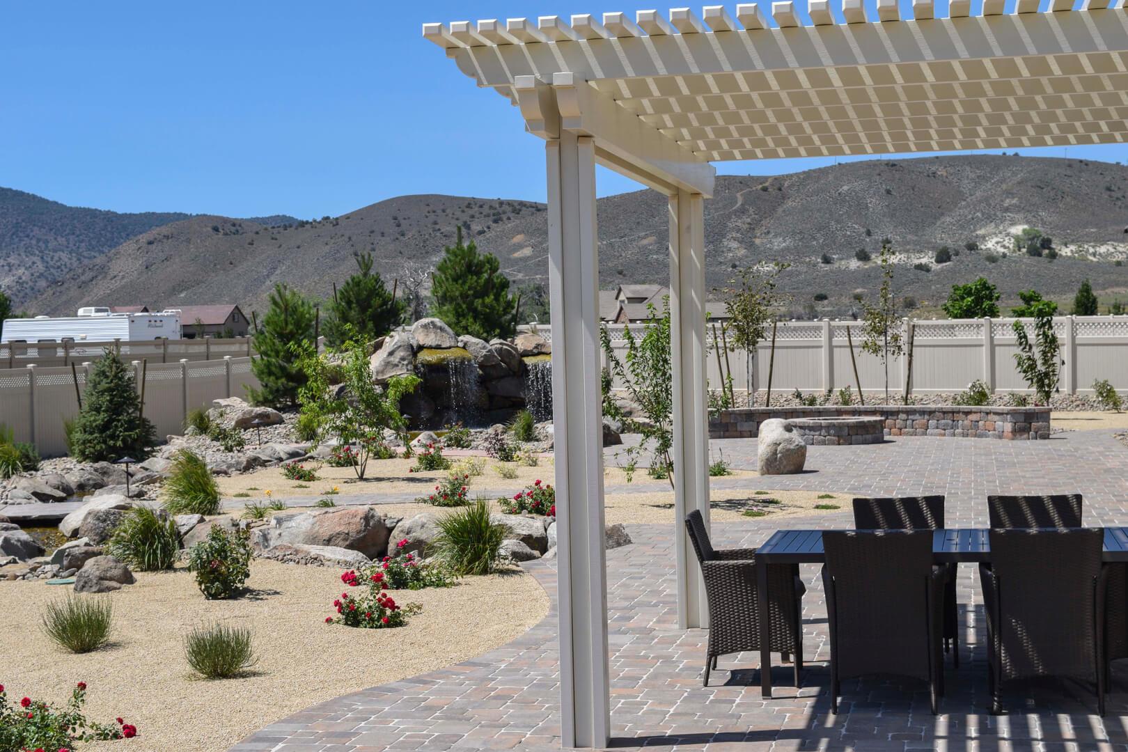 Custom pergola, paver patio and xeriscaping.