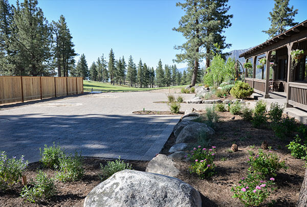 Custom designed layouts for Clear Creek Tahoe Resort with beautiful paver walkways, patios, pergolas, boulder placement, game areas.